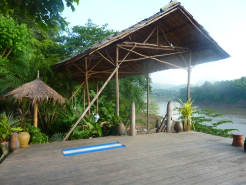 Utopia's gorgeous outdoor yoga platform, overlooking the Nam Khan river.