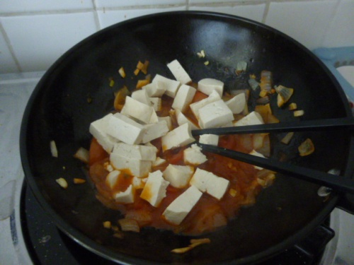 Cooking Palak Paneer with Thai Tofu.